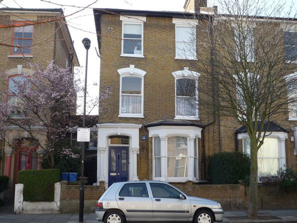 Period conversion flat with large sash windows and high ceilings throughout.