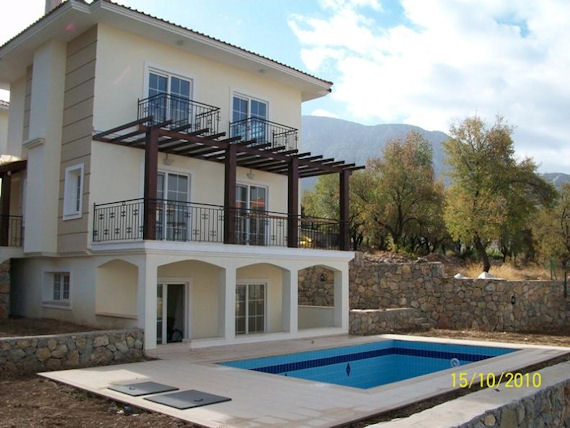 The Akasya community is consisted of 6 detached triplex villas each with their own 32m² private swimming pool and set in own spacious grounds. Beautifully designed and built villas have 4 en-suite bedrooms. The lower ground floor comprises 2 double bedrooms which lead on to a large terrace. Two further double bedrooms are on the first floor each with private balcony. Entrance floor is consisted of open plan kitchen and lounge area with working fire place and accessible to large balcony. The large terraces and balconies overlook the swimming pool and panoramic Ovacik lowland and ideal for alfresco dining on those warm summer evenings.